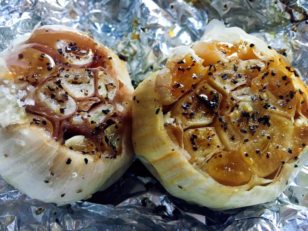Roasting garlic is an easy way to elevate flavors of any dish and bring out the rich and soft flavors of garlic. Prep in just a couple minutes, throw in the oven to roast, and you have a flavor bomb!