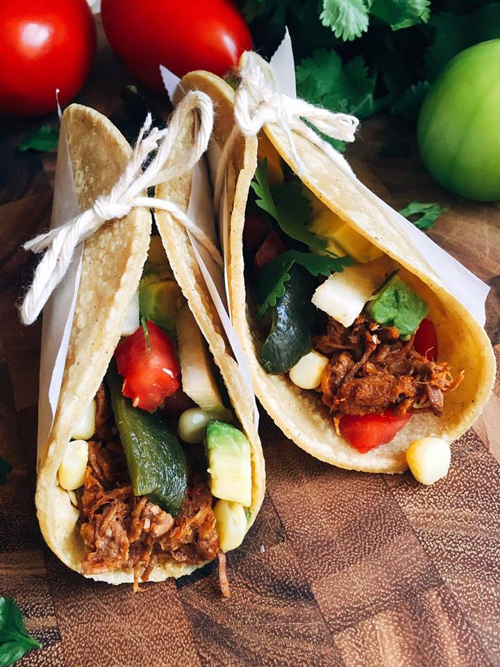 Just 5 minutes to throw everything in a slow cooker will give you an amazing Barbacoa packed full of flavor! These tacos and quick and customizable to please even picky eaters. Check out the post for a time saving hack to shred all this beautiful meat! | Three Olives Branch