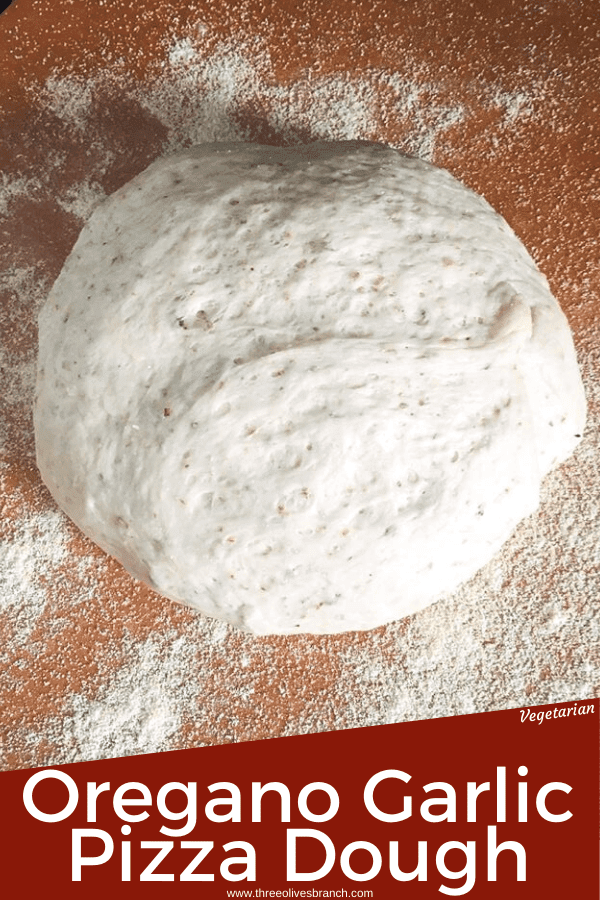Italian Oregano Garlic Pizza Dough is a simple homemade pizza dough perfect for any toppings! Easy homemade pizza night. #pizza #pizzadough #homemadepizza