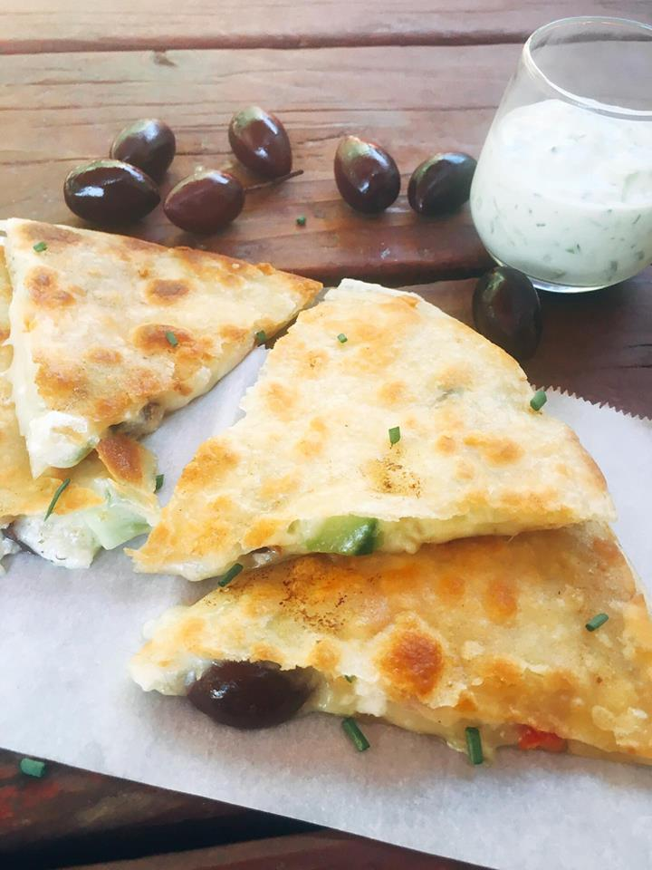 Ready in just 10 minutes! Greek Tzatziki Quesadillas are a great way to sneak some veggies into a fun snack or meal! All the flavors of Greek salad in quesadilla form with some tzatziki sauce inside for extra flavor and dipping.
