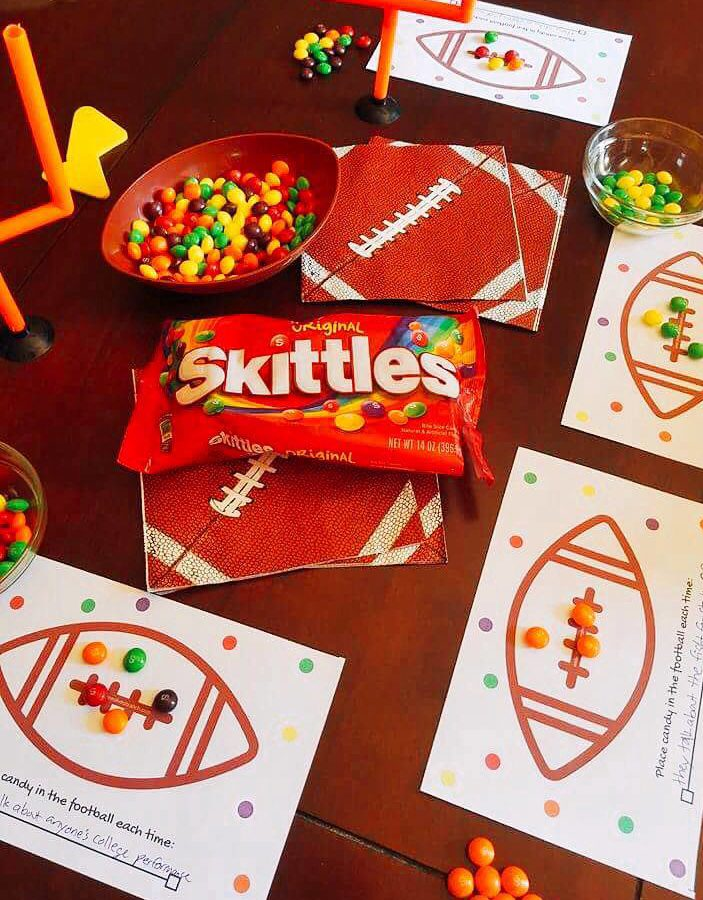 A fun homegating football game! Pick a phrase or event during the game to keep track of with @Skittles as your playing pieces and see who wins! FREE Printable on site! #ad #CallAnEatible #SkittlesHomegating