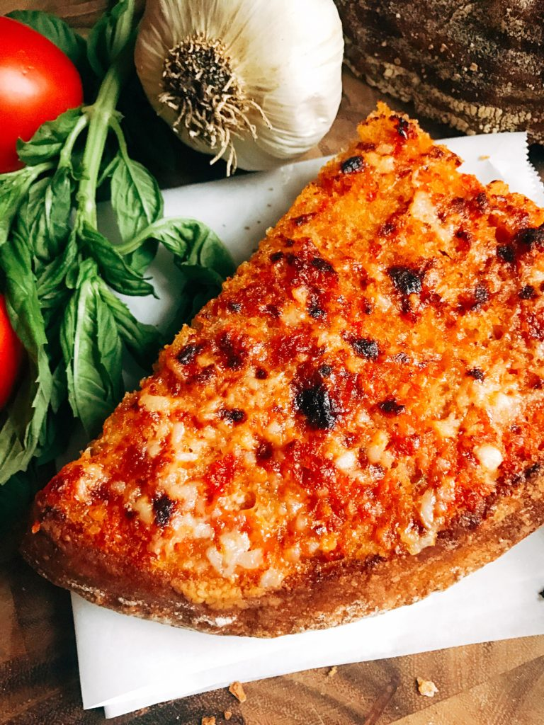 Ready in less than 10 minutes, this Pan con Tomate Garlic Bread is inspired by the classic Pan con Tomate dish in Spain. Tomato and garlic are the stars of this unique bread, perfect as an appetizer, snack, or side for Italian dishes. Inspired by my vacation to Barcelona, this garlic bread is full of flavor. Fast and easy to make! Three Olives Branch | www.threeolivesbranch.com