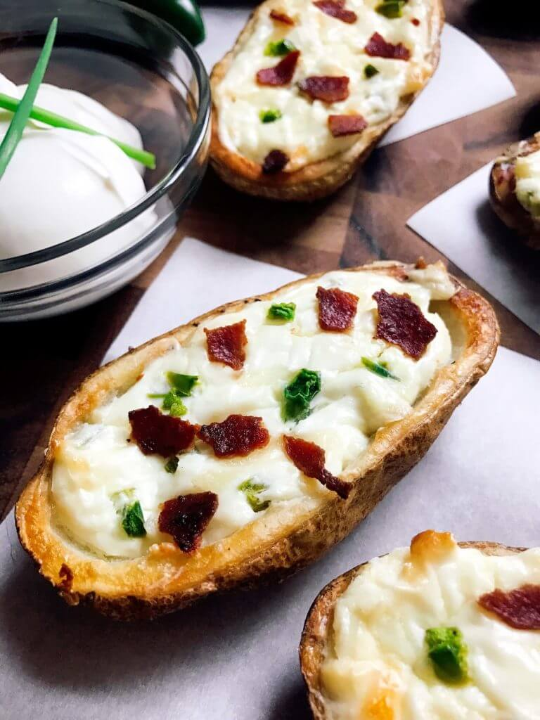 Perfect for the big game, these Jalapeno Popper Potato Skins are one of our favorites! Control the spicy heat level with the amount of jalapeno you use and this is perfect as an appetizer, especially for football games! Easy to make and vegetarian friendly. Three Olives Branch | www.threeolivesbranch.com