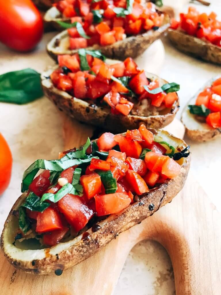 Perfect as a snack, appetizer, or lunch, these potato skins are full of fresh and bright flavors. Each element can be made ahead for fast and easy assembly. Perfect for entertaining, a party, or the big game day. Balsamic, tomato, and basil brighten the cheese and chicken for a fresh treat. Gluten free. Balsamic Chicken Bruschetta Potato Skins | Three Olives Branch | www.threeolivesbranch.com