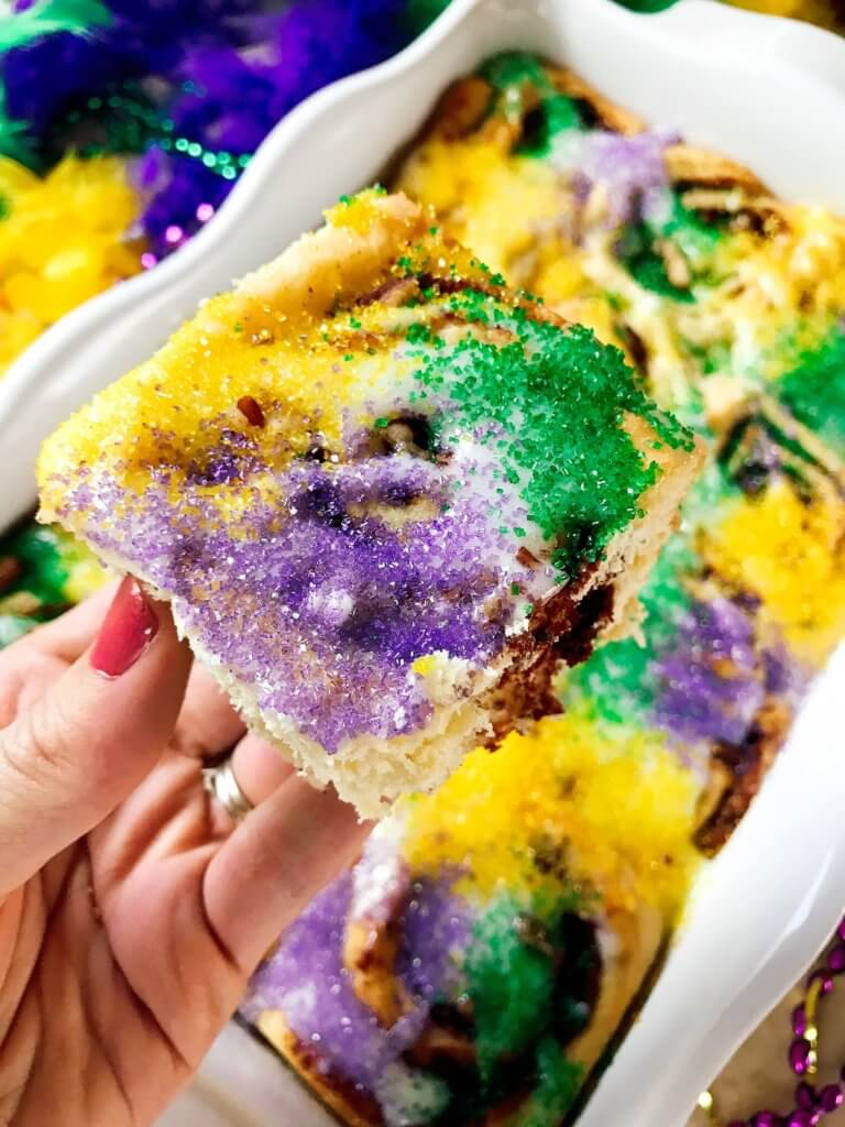 Make in advance for an easy breakfast! Comfort food perfect for the holiday. Vegetarian and kid friendly. Pecan, cinnamon, and flaky dough. Mardi Gras King Cake Cinnamon Rolls | Three Olives Branch | www.threeolivesbranch.com
