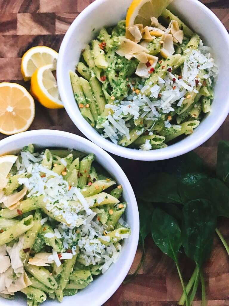 Less than 15 minutes, this light and healthy dish is ready! Perfect for busy nights, full of nutrition, and a great way to sneak healthy food into a meal. Vegetarian or add chicken, sausage, or shrimp for meat lovers. Fast, simple, and easy to make. Great for spring and summer lighter dishes. Spinach Artichoke Pesto Pasta   Three Olives Branch   www.threeolivesbranch.com