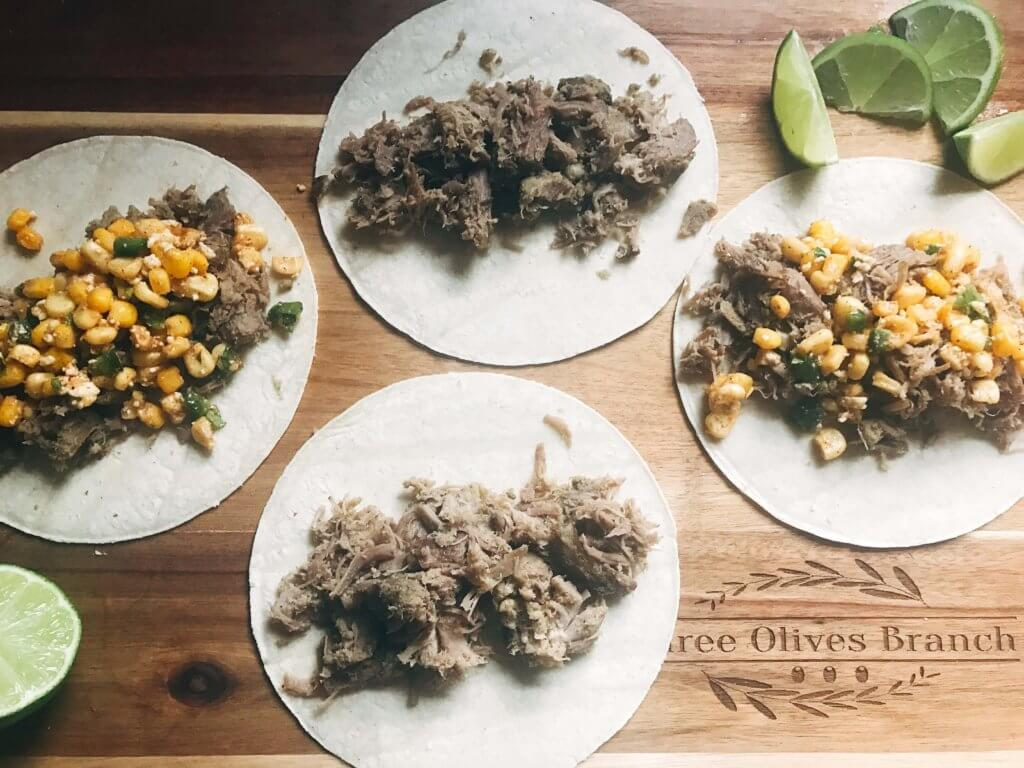 Less than 30 minutes for these fast and simple tacos! Easy to make and perfect for leftovers. Fresh corn salsa pairs perfectly with the seasoned pork. Pork Carnitas Mexican Street Corn Tacos | Three Olives Branch | www.threeolivesbranch.com