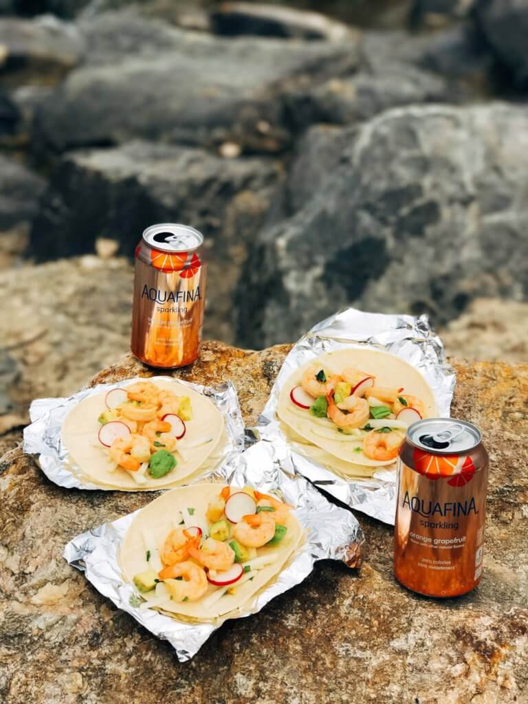 Less than 30 minutes for these simple and fresh shrimp tacos. Perfect for on-the-go food, full of bright and fresh flavors. Shrimp, orange, grapefruit, avocado, and jicama inspired by Aquafina Sparkling Water. A great twist on a seafood taco for Mexican night. Quick and easy to make, perfect for summer. Grapefruit Orange Shrimp Tacos with Jicama Slaw   Three Olives Branch   www.threeolivesbranch.com