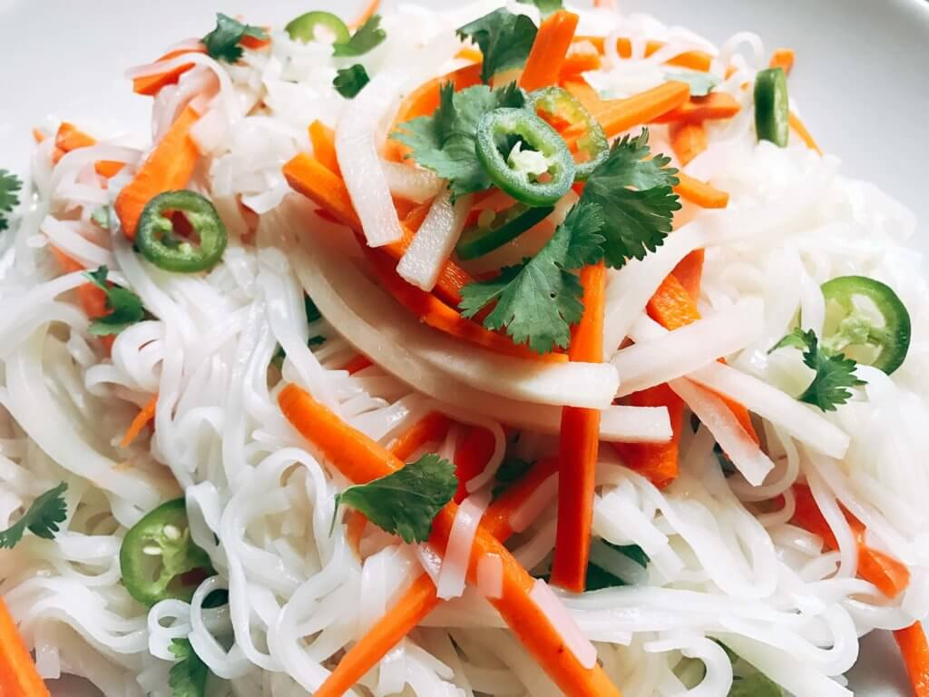 A simple and fast gluten free side dish that is perfect for summer grilling and entertaining. Vegan and vegetarian, this noodle salad is easy to make and a great fresh addition to a BBQ or party like the 4th of July or Father's Day. Add some tofu, chicken, or shrimp for a full dinner meal. Pickled carrots and daikon radish in a rice vinegar bright a fresh brightness and acidity. Make it spicy with some serrano or jalapeno. Vietnamese Pickled Vegetable Rice Noodle Salad   Three Olives Branch   www.threeolivesbranch.com