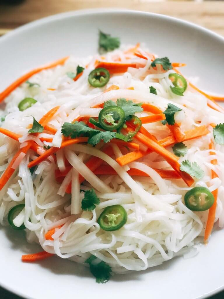 A simple and fast gluten free side dish that is perfect for summer grilling and entertaining. Vegan and vegetarian, this noodle salad is easy to make and a great fresh addition to a BBQ or party like the 4th of July or Father's Day. Add some tofu, chicken, or shrimp for a full dinner meal. Pickled carrots and daikon radish in a rice vinegar bright a fresh brightness and acidity. Make it spicy with some serrano or jalapeno. Vietnamese Pickled Vegetable Rice Noodle Salad | Three Olives Branch | www.threeolivesbranch.com