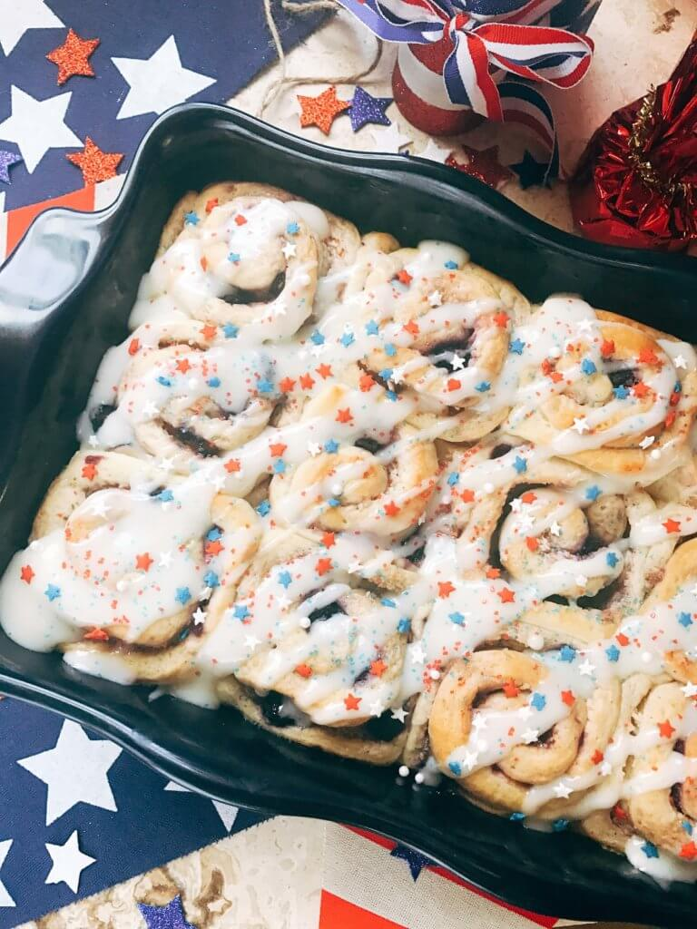 Red, white, and blue sweet rolls for a patriotic morning! A twist on cinnamon rolls, these are filled with cream cheese and mixed berries for a summer treat. Great for patriotic parties and BBQs like Labor Day, Memorial Day, and 4th of July. Make them in advance for a quick and easy breakfast or brunch to start the holiday. They even work as a dessert! Vegetarian and kid friendly. Patriotic Berry Sweet Rolls   Three Olives Branch   www.threeolivesbranch.om