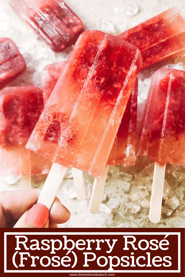 Popsicles made of rosé wine and raspberries! Simple to make and a great alcoholic adult treat for the warm and hot summer days. A twist on the frosé (frozé) trend, putting your favorite pink rose wine in popsicle form. A perfect treat or poptail for a cookout, barbecue, or grilling day. BBQ parties never tasted so good! Cocktail on a stick. Raspberry Rosé (Frosé) Popsicles #popsicles #poptails #boozypopsicles #rosewine