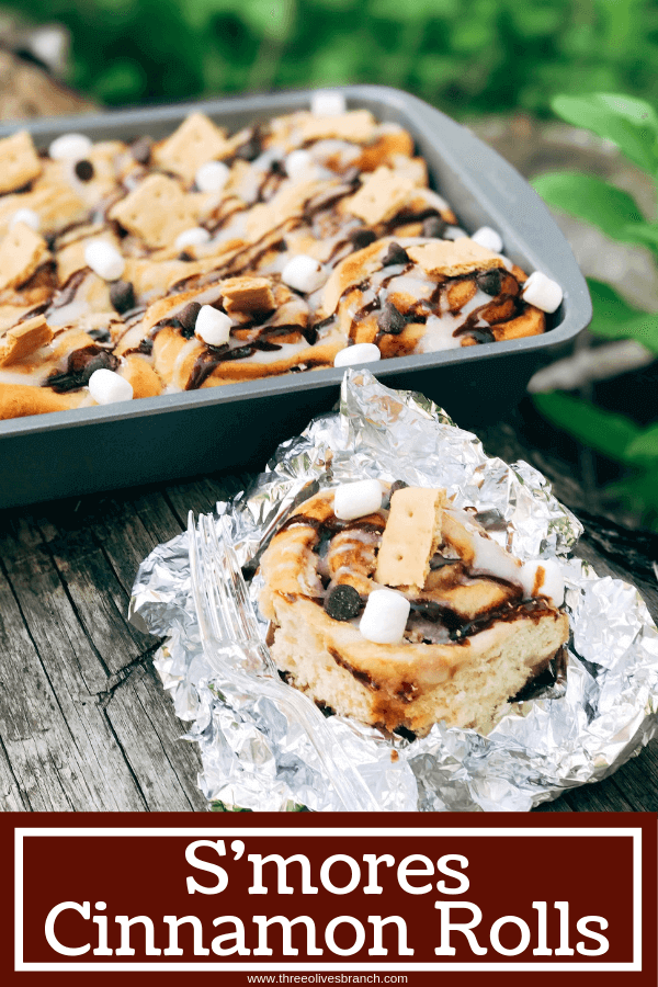 Great for camping and enjoying summer flavors, these rolls are filled with marshmallow fluff, chocolate, and graham crackers. Hold over great for camping trips or cookout parties. Kid friendly and a great way to celebrate summer whether a holiday like 4th of July or a BBQ cookout. S'mores Cinnamon Rolls #smores #campingrecipes #summerrecipes