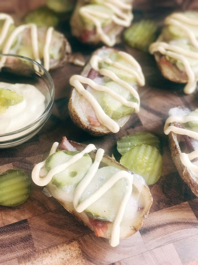 25 minutes for potato skins filled with Swiss cheese, leftover ham, pickles, and a mustard sauce. Gluten free and a perfect party appetizer or Super Bowl game day snack. Cubano Potato Skins | Three Olives Branch | www.threeolivesbranch.com #potatoskins #gamedayrecipe #leftoverham #cubano