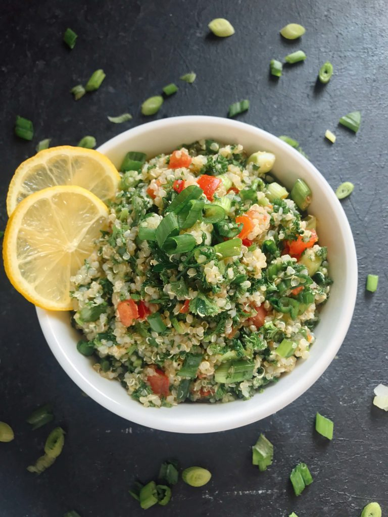 Ready in 15-20 minutes, this tabbouleh is perfect as a side or lunch. Fresh parsley, green onion, tomatoes, lemon, and mint are mixed with quinoa for a twist on classic tabouleh (tabouli). Vegan, vegetarian, gluten free. Vegan Quinoa Tabbouleh | Three Olives Branch | www.threeolivesbranch.com #vegan #tabbouleh #healthy