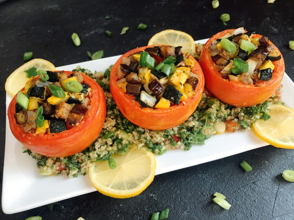 Eggplant, zucchini, and yellow squash stuffed in tomatoes for a twist on classic ratatouille. A healthy recipe that is vegan, vegetarian, low carb keto, gluten free (gf), whole 30, and paleo. Vegan Quinoa Tabbouleh | Three Olives Branch | www.threeolivesbranch.com #vegan #healthyrecipe
