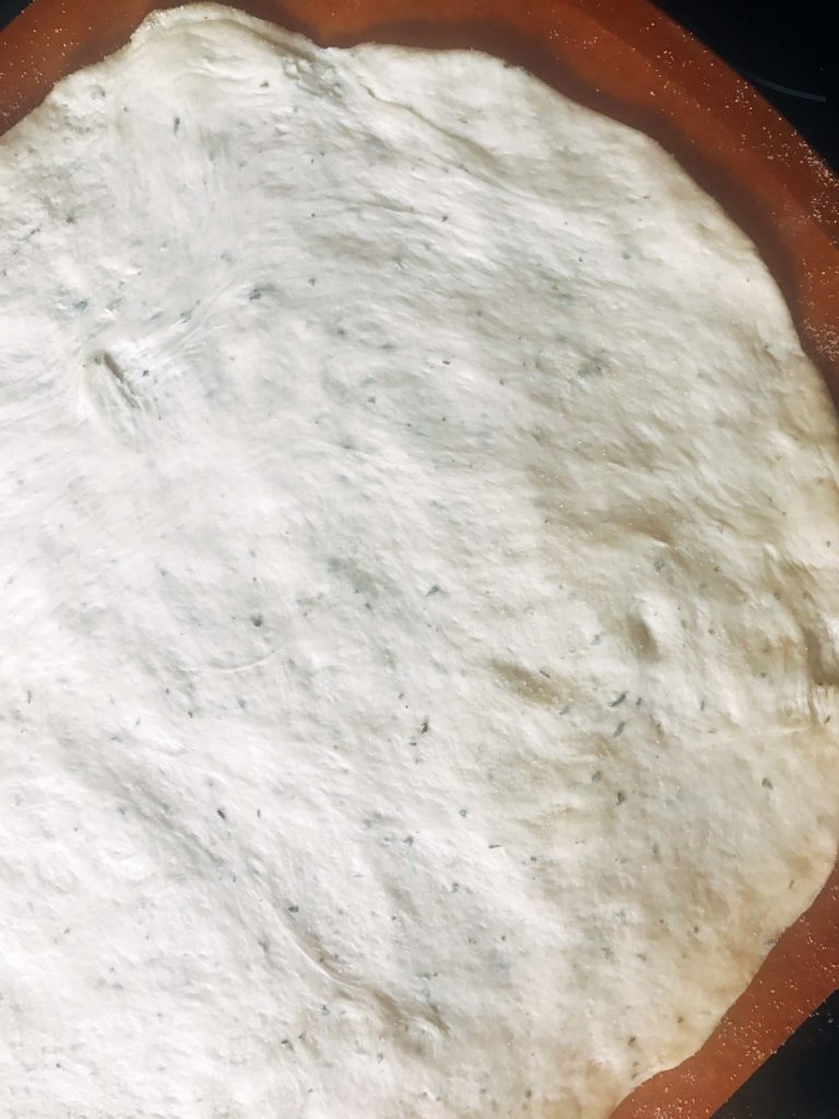 Homemade pizza dough made with Ranch seasoning for a flavorful pizza crust. A great pizza crust base for unique pizza recipes like buffalo chicken pizza or buffalo cauliflower pizza for game day or the Super Bowl. Vegetarian. Ranch Pizza Crust | Three Olives Branch | www.threeolivesbranch.com #gameday #superbowl #pizzadough #pizzacrust