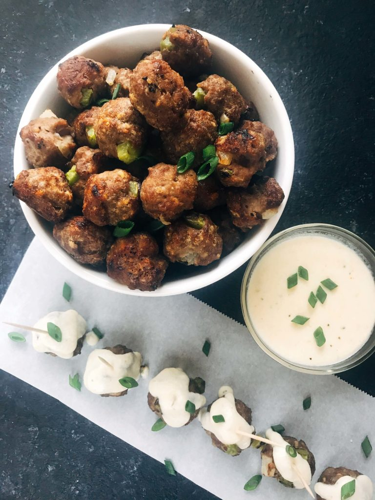 Beef meatballs mixed with green bell pepper and onion, served with a provolone cheese dipping sauce. Traditional Philly Cheesesteak flavors in meatball form. Perfect for game day, especially rooting for the Philadelphia Eagles, and the Super Bowl. Simple to make. Philly Cheesesteak Meatballs | Three Olives Branch | www.threeolivesbranch.com #superbowl #appetizer #meatball #gameday #football