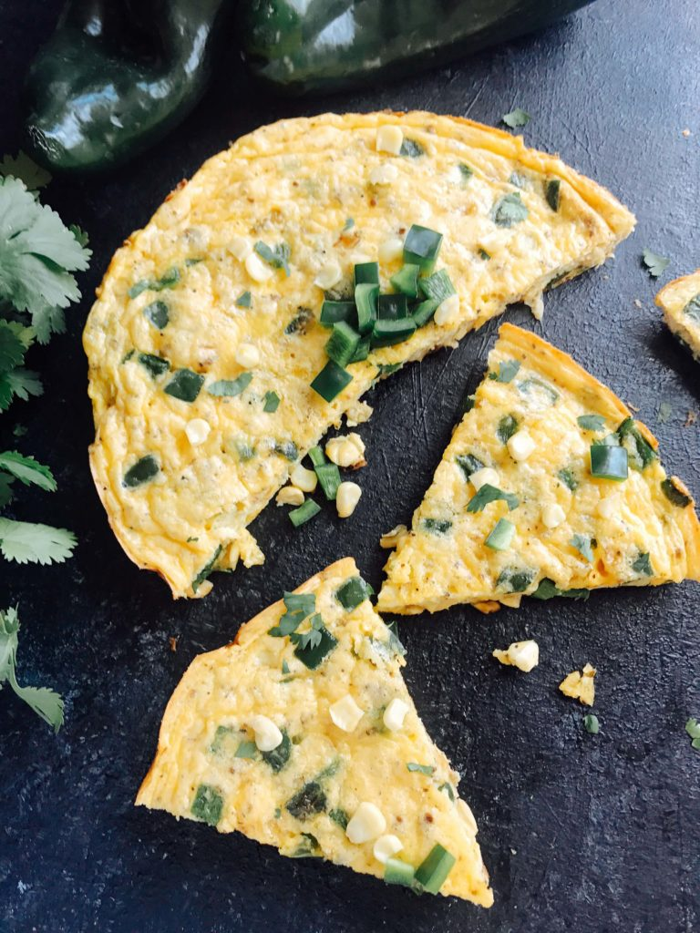 A quick and simple breakfast recipe, this frittata is full of poblano pepper and corn. Vegetarian and gluten free (GF). Easy brunch for a crowd with Mexican flavors. Poblano, Corn, and Cheddar Frittata | Three Olives Branch | www.threeolivesbranch.com #mexicanbreakfast #mexicanbrunch #easybreakfast #fastbreakfast #glutenfree
