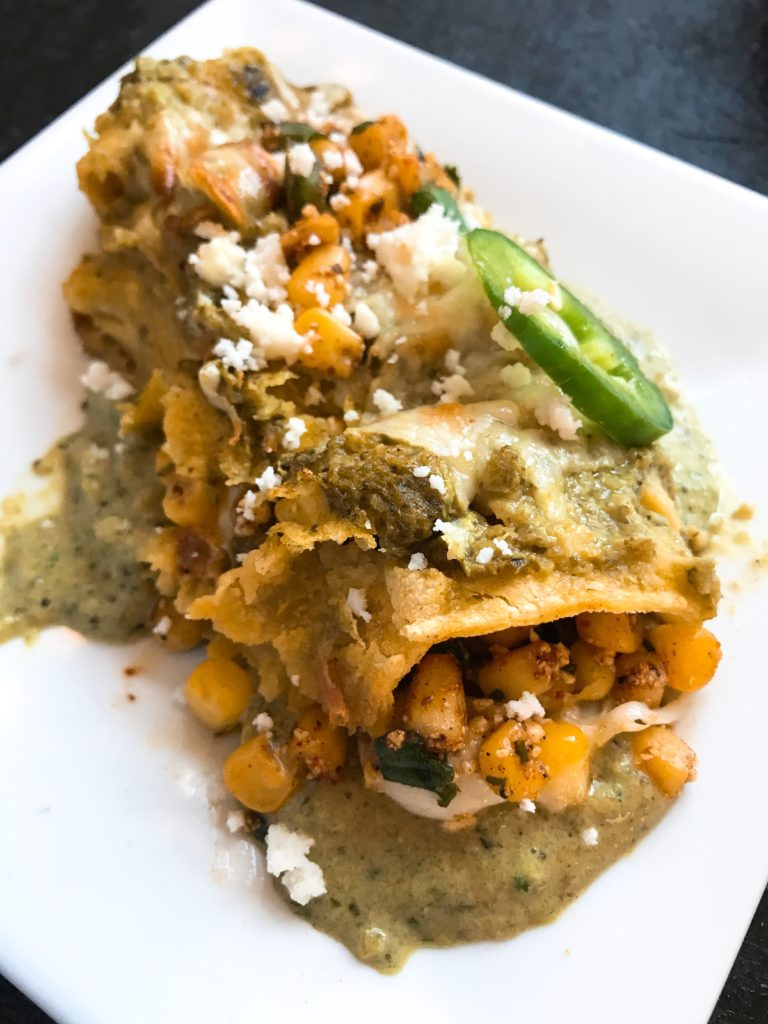 Corn, jalapeno peppers, cilantro, lime, chili powder, and cotija cheese are combined to make a Mexican Street Corn (elote) salsa that is the star of these enchiladas.. Layered with Monterey Jack cheese and topped with Roasted Poblano and Lime Enchilada Sauce. Vegetarian. Mexican Street Corn Enchiladas | Three Olives Branch | www.threeolivesbranch.com #vegetarian #mexican #enchiladas