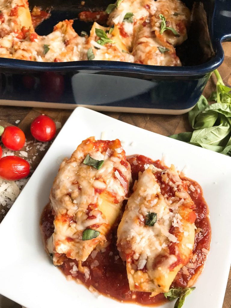 These stuffed shells are a fun twist on an Italian recipe classic! Cherry tomatoes, fresh basil, and mozzarella cheese are stuffed with chicken in pasta shells and baked in the oven. A great freezer meal and kid friendly. Chicken Caprese Stuffed Shells   Three Olives Branch   www.threeolivesbranch.com