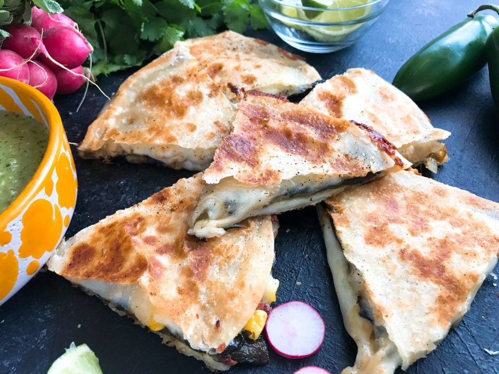 Quick and simple Mexican recipe ready in 20 minutes! The flavors of a chile relleno in a quesadilla. Roasted poblano peppers, cheese, and some vegetables. Serve with your favorite dip or sauce. Vegetarian, simple appetizer, dinner, lunch, or snack. Vegetarian Chile Relleno Quesadilla | Three Olives Branch | www.threeolivesbranch.com #cincodemayo