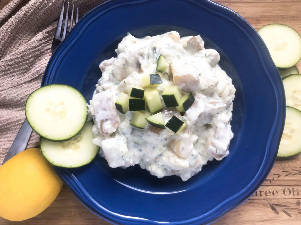 Simple side dish recipe perfect for BBQ, grilling, and summer parties. Tzatziki flavors of Greek yogurt, lemon, dill, cucumber, and garlic lift this potato salad to a new and unique side dish. Vegetarian, gluten free (GF). Healthy Tzatziki Potato Salad   Three Olives Branch   www.threeolivesbranch.com