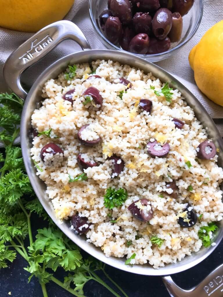 Ready in less than 10 minutes, this Vegan Mediterranean Lemon Olive Couscous recipe is full of fresh and bright flavors for a light side dish. Great with chicken, seafood, and vegetables. A simple and easy recipe to make. #fastrecipes #olives #lemon #sidedishrecipes