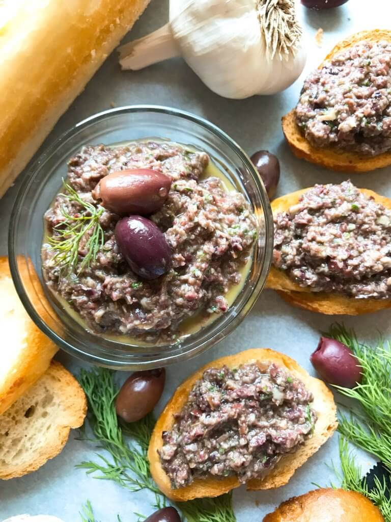 Ready in 5 minutes, this tapenade recipe is vegan, vegetarian, paleo, keto low carb, Whole 30, and gluten free (GF). Perfect as a holiday appetizer for Christmas, Thanksgiving, Easter, and more. Serve with crostini, chicken, pasta, vegetables, and more. Vegan Artichoke Olive Tapenade #holidayappetizer #olive #veganrecipe