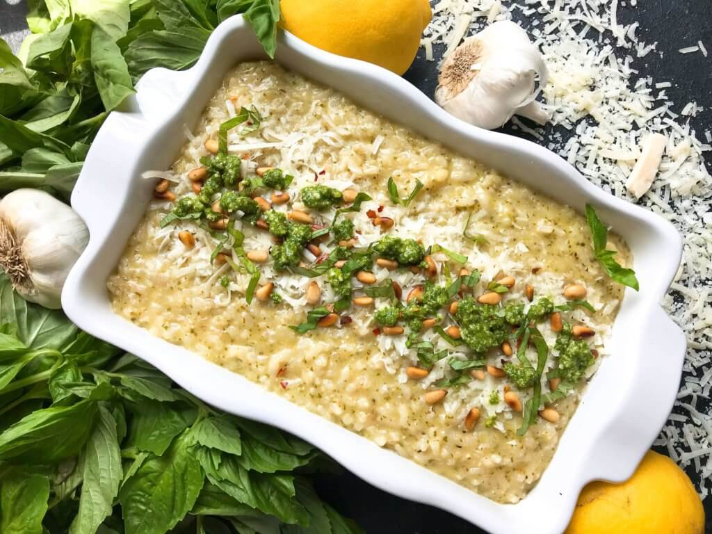 Cheesy Italian Parmesan risotto recipe mixed with fresh basil pesto. Vegetarian and gluten free (GF). Eat on its own, as a side dish, or add your favorite protein. Basil Pesto Risotto | Three Olives Branch | www.threeolivesbranch.com #vegetarianrecipes #risotto #italianrecipes #glutenfree #pesto