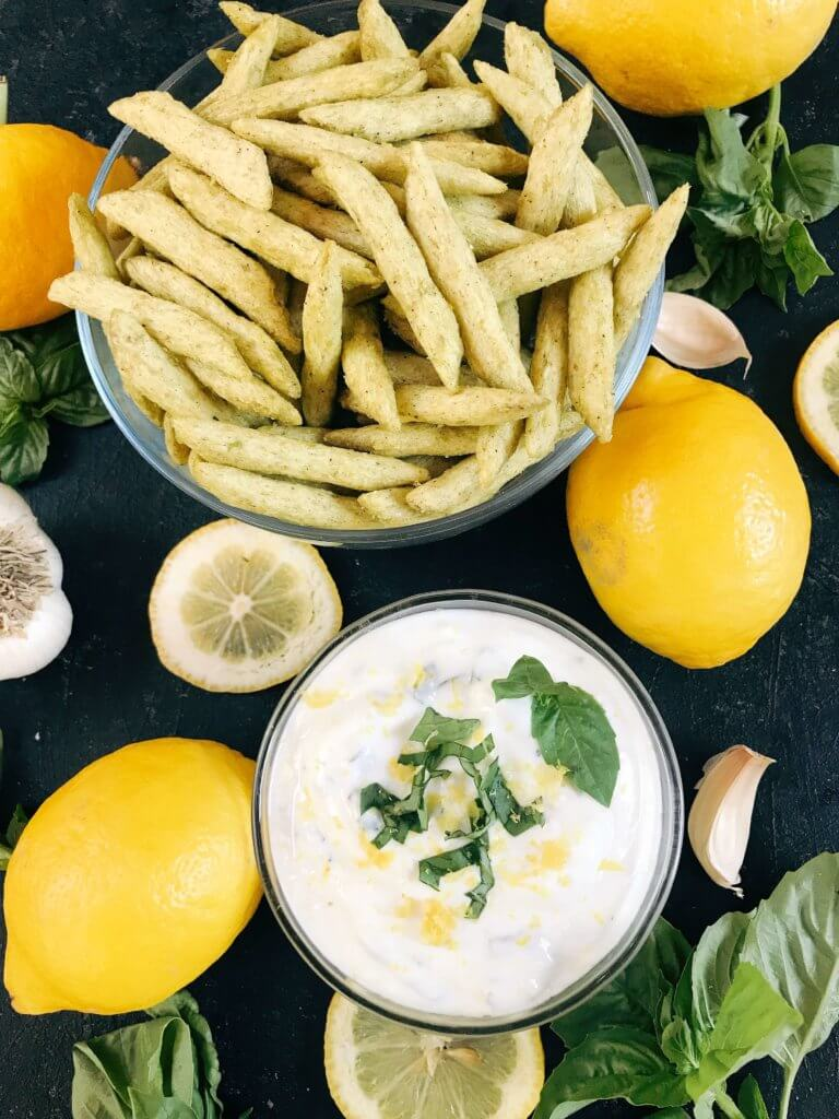 Ready in just minutes, this easy dipping sauce recipe is made with plain Greek yogurt, fresh basil, lemon, and garlic. Dunk your favorite vegetables, chips, or Harvest Snaps! Quick appetizer or snack that is gluten free (gf) and vegetarian. Healthy Lemon Basil Dipping Sauce with Harvest Snaps #appetizerrecipes #glutenfree #vegetarian