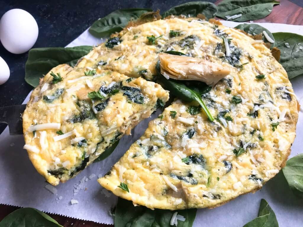 Ready in 20 minutes, this frittata is based off of Spinach Artichoke Dip. Vegetarian and gluten free (GF) recipe that is simple,. fast, and easy. Great for breakfast or brunch. Spinach, artichoke hearts, and Parmesan cheese. Spinach Artichoke Frittata #breakfastrecipes #brunch #glutenfreerecipes