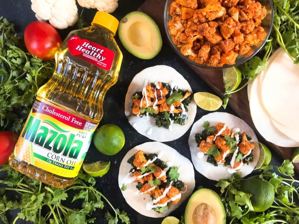 Simple and easy roasted cauliflower taco recipe seasoned with smoked paprika, lime, and Mazola corn oil. Vegetarian, vegan, and gluten free (gf). Fresh and simple Mexican recipe. Smoked Paprika and Lime Cauliflower Tacos #tacotuesday #mexicanrecipes #MakeItMazola #simpleswap #ad