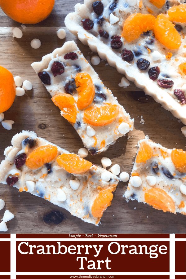 A fast and easy dessert recipe ready in just 30 minutes. Cranberry Orange Tart has a soft cookie shell with a cream cheese filling mixed with dried cranberries, orange zest, and white chocolate chips. #christmasdessert #holidayrecipes #holidaybaking #fruittart