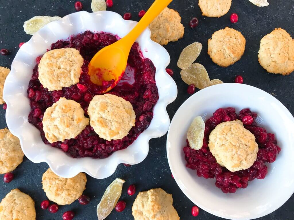 Holiday Cranberry Ginger Cobbler is a perfect quick and simple Christmas or Thanksgiving dessert ready in 30-45 minutes. A cranberry ginger filling is topped with light ginger cinnamon biscuits. A perfect holiday dessert. #christmasdessert #thanksgivingdessert #holidaydessert #cranberryrecipes