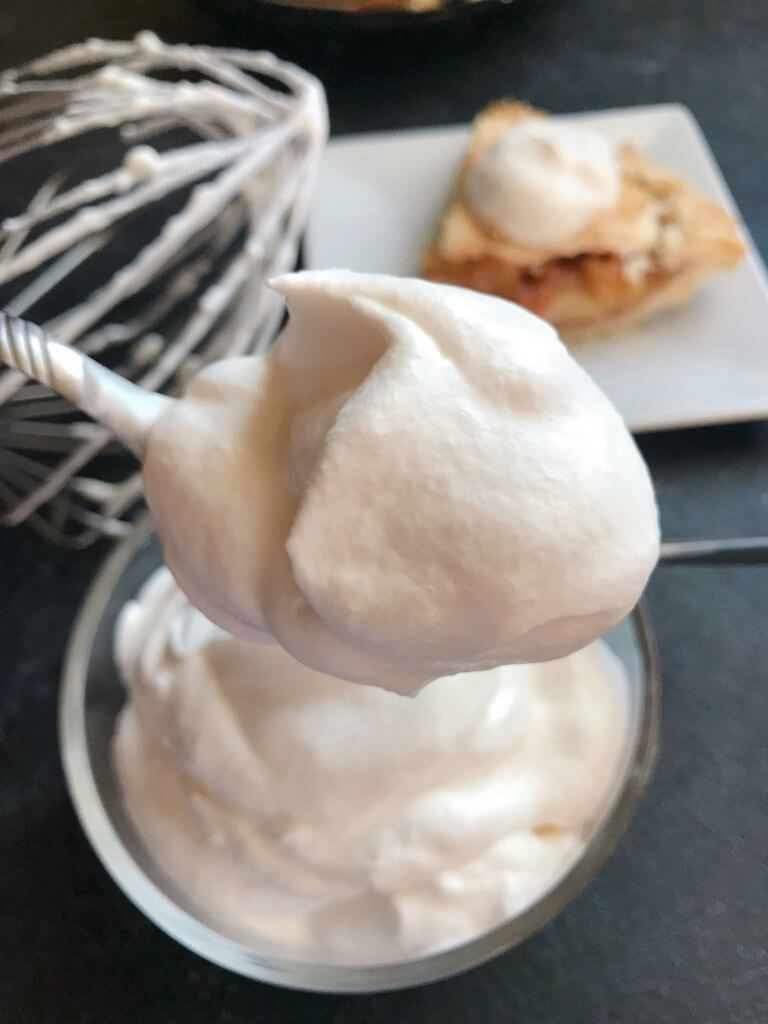 A fast and simple 5 minute whipped cream. Learn How To Make Whipped Cream with just three ingredients for your holiday desserts. #holidaydesserts #easydesserts #whippedcream #whipcream