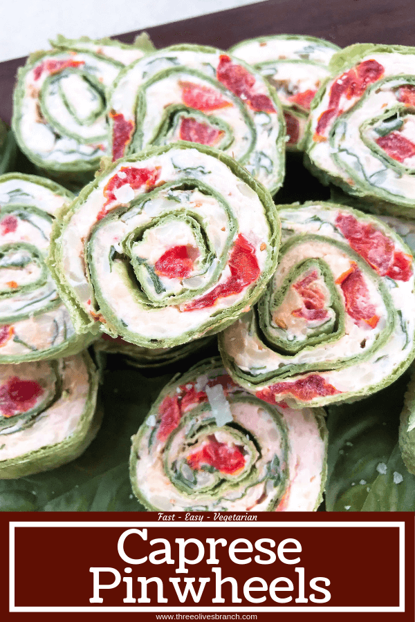 Fast and simple appetizer recipe. Caprese Pinwheel Roll Ups are filled with cream cheese, tomatoes, fresh basil, mozzarella, and Parmesan rolled up in tortillas and sliced into party finger food bites. Vegetarian. #caprese #appetizerrecipes #vegetarianrecipes