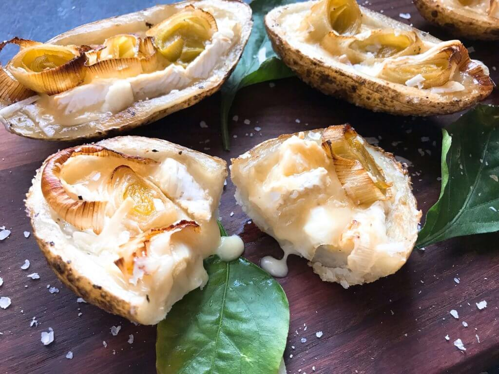 A simple snack recipe for game day and entertaining. Roasted Leek and Brie Potato Skins are vegetarian and gluten free. Creamy cheese and roasted leeks in a potato skin shell. Fun party finger food. #appetizerrecipes #glutenfreerecipes #vegetarianrecipes
