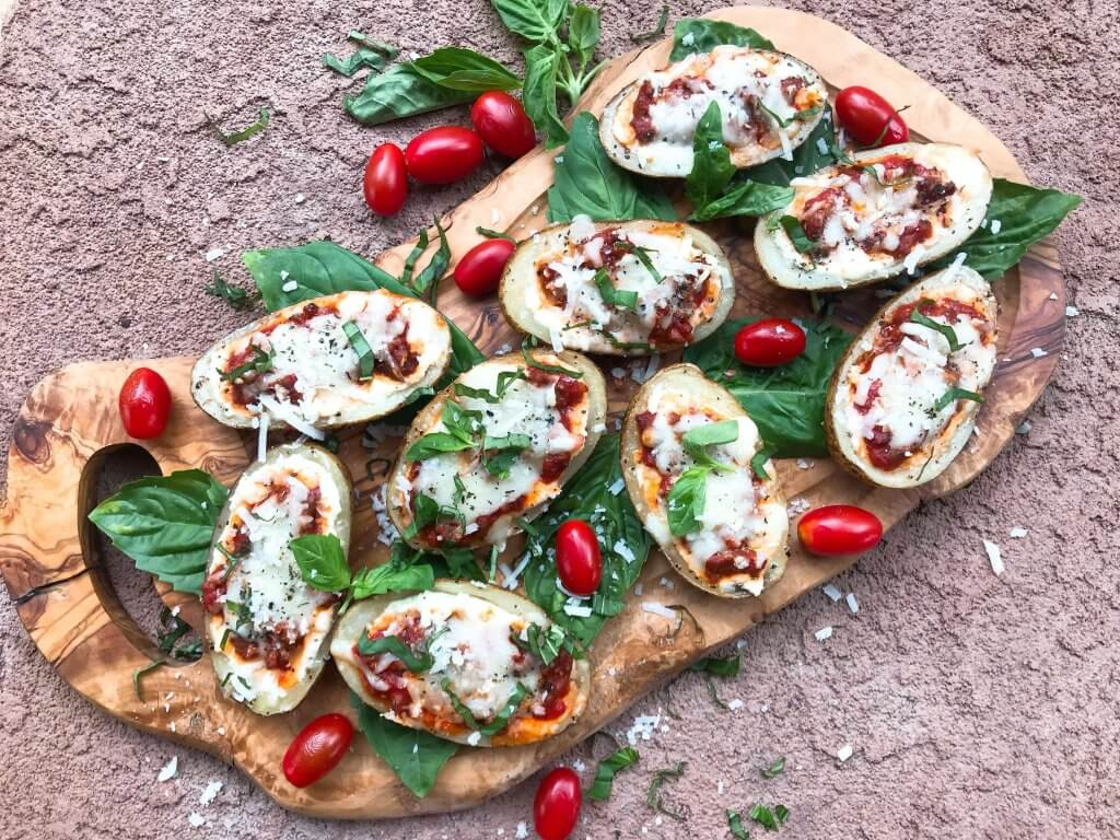 Beef lasagna potato skins recipe with ricotta, Parmesan, and mozzarella cheeses layered with marinara sauce and ground beef in a potato skin shell. Gluten free. #italianrecipe #potatoskins #beeflasagna #glutenfreerecipes