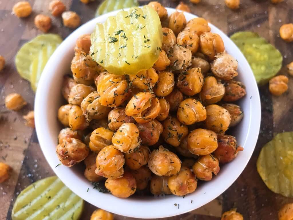 A simple and easy recipe, Dill Pickle Roasted Chickpeas are a healthy appetizer or snack and perfect for game day or entertaining. Vegan, gluten free, and dairy free. Garbanzo beans are roasted with dill and pickle brine. #roastedchickpeas #veganrecipes #gamedayrecipes #healthyappetizers