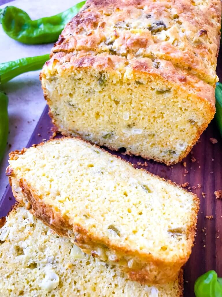 A simple cornbread recipe, Hatch Green Chile Cheddar Cornbread highlights fall flavors. Roasted diced chile peppers with cheddar cheese and corn. Great for fall on its own or with chili. #cornbread #hatchpeppers