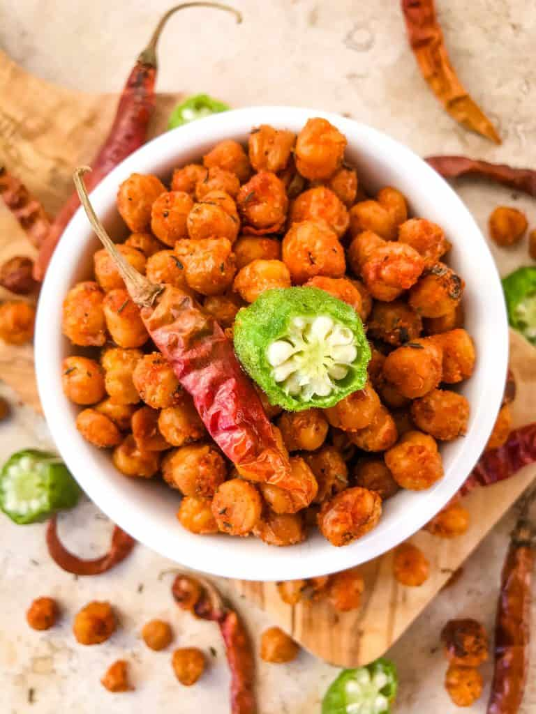 Cajun Roasted Chickpeas are a simple and easy spicy snack recipe. Vegetarian, vegan, gluten free, dairy free. Cajun spices flavor these crunchy garbanzo beans. Great for Mardi Gras, game day, appetizers, parties, and snacks. #roastedchickpeas #healthysnack #cajun