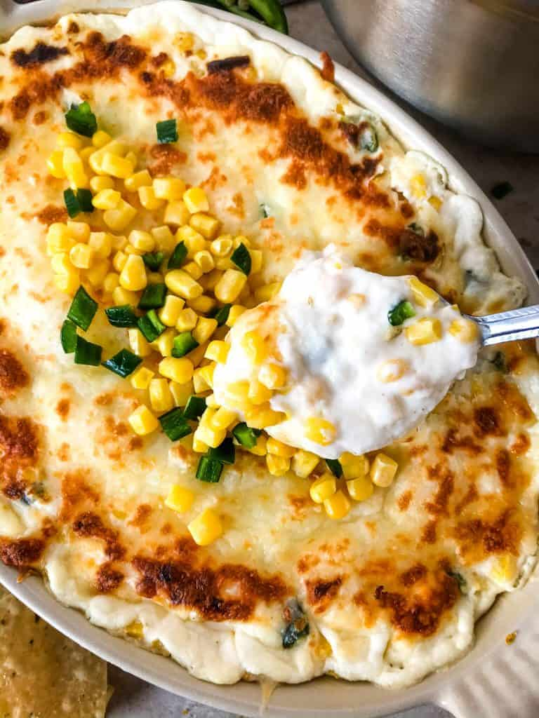 Warm Corn Cheese Dip is packed with three cheeses and corn for a fast and easy appetizer recipe. It takes just minutes to make this vegetarian and gluten free corn dip for a party, game day, or holiday appetizer. #corndip #cheesedip