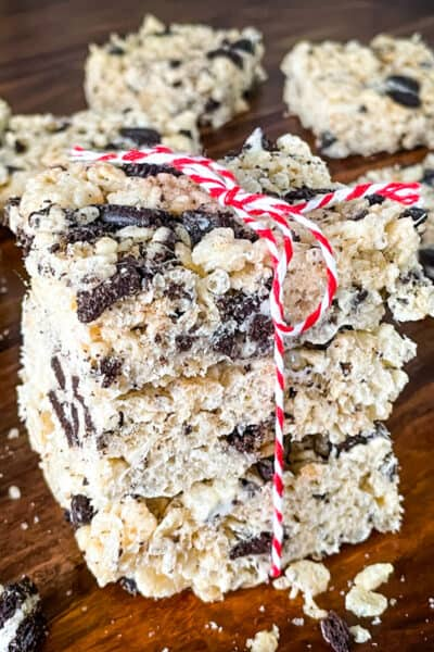 A stack of Oreo Rice Krispie Treats tied with a red and white twine