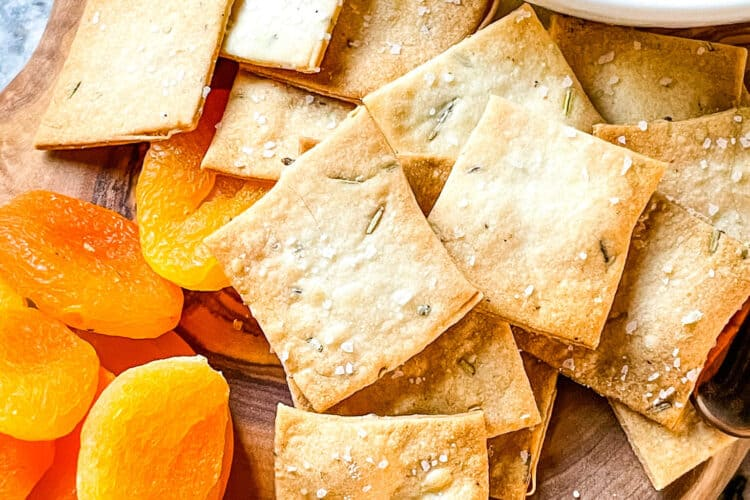 A pile of the crackers on a charcuterie board