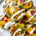 A pile of Loaded Smashed Brussels Sprouts drizzled with sour cream