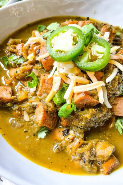 The Hatch Pork Green Chili in a bowl with toppings