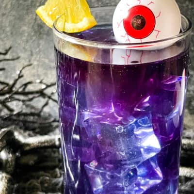 Close up of one Purple People Eater Halloween Cocktail (+Mocktail)