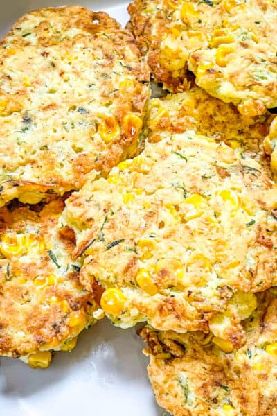 Closer top view of Corn and Zucchini Fritters in a pile